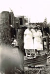 Nurses at the scene of a fire which destroyed their quarters in 1945