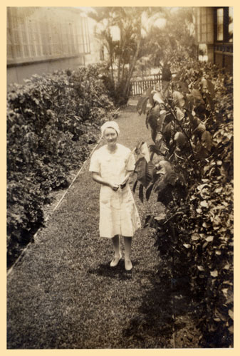 Nurse Dorothy Beasley in the garden at Tannachy Hospital, Rockhampton ca. 1940