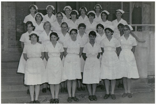 A group of nurses on the steps of the Rockhampton Hospital ca. 1968