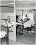 Sister Avis Smith (née Auton) in the Children's Ward of the Rockhampton Hospital in 1964